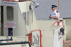 © Licensed to London News Pictures. 03/08/2011. London, UK. Police at the scene on the River Thames, London today (03/08/2011) where a crew member on the Woolwich Ferry has died after falling off the boat.  The 19-year-old was found by the coastguard and pronounced dead at the scene..The Woolwich Ferry, a free service between Woolwich and North Woolwich, has been suspended while an investigation is carried out. Photo credit : Grant Falvey/LNP