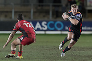 Tyler Morgan of the Newport Gwent Dragons wrong foots Phil Burleigh of Edinburgh. Guinness Pro12 rugby match, Newport Gwent Dragons  v Edinburgh rugby at Rodney Parade in Newport, South Wales on Sunday 27th November 2016.<br /> pic by Simon Latham, Andrew Orchard sports photography.