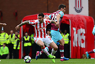 Johnathan Calleri of West ham battles with Geoff Cameron of Stoke city.Premier league match, Stoke City v West Ham Utd at the Bet365 Stadium in Stoke on Trent, Staffs on Saturday 29th April 2017.<br /> pic by Bradley Collyer, Andrew Orchard sports photography.