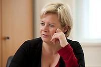 04 NOV 2010, BERLIN/GERMANY:<br /> Gesine Loetzsch, Die Linke, Parteivorsitzende, waehrend einem Interview, in Ihrem Buero, Karl-Liebknecht-Haus<br /> IMAGE: 20101104-01-014<br /> KEYWORDS: Gesine Lötzsch