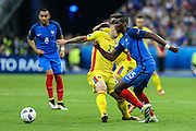 SAINT-DENIS, FRANCE, 10.06.2016 - FRANCE-ROMANIA - Paul Pogba (D) of France, dispute the ball with Cristian Sapunaru of Romania, in a match valid for the 1st round of Group A of Euro 2016 in the Stade de France in Saint-Denis, on Friday