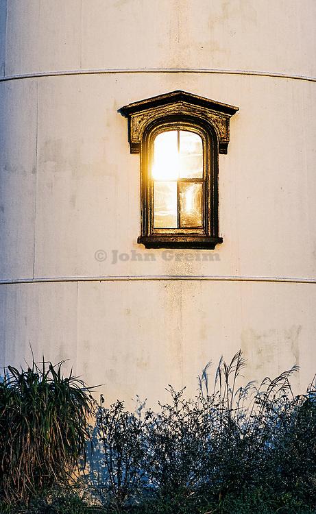 Sunrise reflected in lighthouse window, Chatham Light, Chatham, Cape Cod, MA