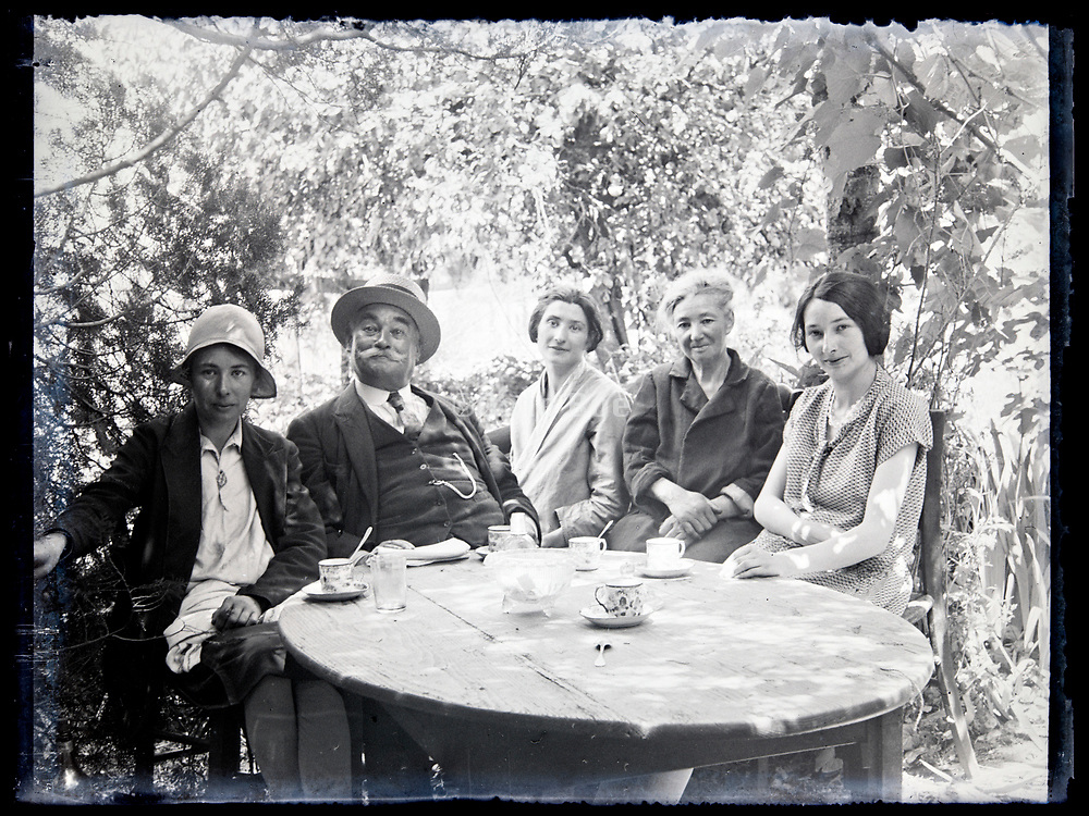 family happy reposing in the garden on a sunny day France, circa 1930s
