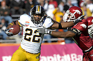 January 1, 2008 - Dallas, TX...Running back Tony Temple #22 of the Missouri Tigers brakes up field against pressure from defensive back Michael Grant #8 of the Arkansas Razorbacks in the first quarter, during the 72nd AT&T Cotton Bowl Classic at the Cotton Bowl in Dallas, Texas on January 1, 2008...The Tigers defeated the Razorbacks 38-7.  .Peter G. Aiken/CSM.