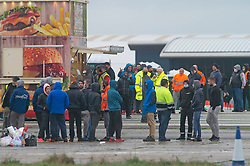 © Licensed to London News Pictures 23/12/2020.        Manston, UK. The Army and NHS staff have arrived at Manston Airport to administer Covid-19 lateral flow tests to truckers who are stranded in Kent. Angry lorry drivers blockading local roads and clashed with police in Kent this morning. France have closed its borders to all freight traffic because of the new Coronavirus strain. Photo credit:Grant Falvey/LNP