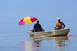Fishing Using Umbrella In The Everglades