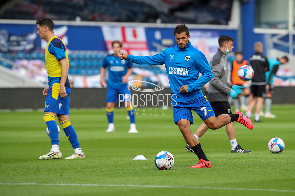 AFC Wimbledon midfielder Cheye Alexander (7) warming up prior to kick off during the EFL Trophy Group O match between AFC Wimbledon and Charlton Athletic at the Kiyan Prince Foundation Stadium, London, England on 1 September 2020.