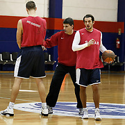 Efers Pilsen's coach Velimir PERASOVIC (C) and Kerem TUNCERI (R) seen during their Turkish basketbol team Efes Pilsen training at the Efes Pilsen training center in Istanbul Turkey on Sunday 13 February 2011. Photo by TURKPIX