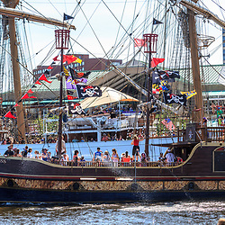 Baltimore, MD, USA - June 16, 2012: A pirate ships sails through Inner Harbor in the City of Baltimore, Maryland.