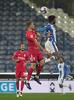 Huddersfield Town's Fraizer Campbell jumps with Birmingham City's Marc Roberts<br /> <br /> Photographer Mick Walker/CameraSport<br /> <br /> The EFL Sky Bet Championship - Huddersfield Town v Birmingham City - Tuesday 2nd March 2021 - The John Smith's Stadium - Huddersfield<br /> <br /> World Copyright © 2020 CameraSport. All rights reserved. 43 Linden Ave. Countesthorpe. Leicester. England. LE8 5PG - Tel: +44 (0) 116 277 4147 - admin@camerasport.com - www.camerasport.com