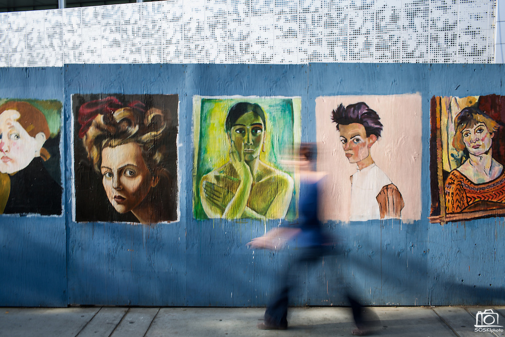 Attendees walk past a construction site wall near the Student Union painted by Humanities & Arts students during Humanities & Arts Day Student Showcase at San Jose State University's Student Union Barrett Ballroom in San Jose, California, on October 25, 2013. (Stan Olszewski/SOSKIphoto)