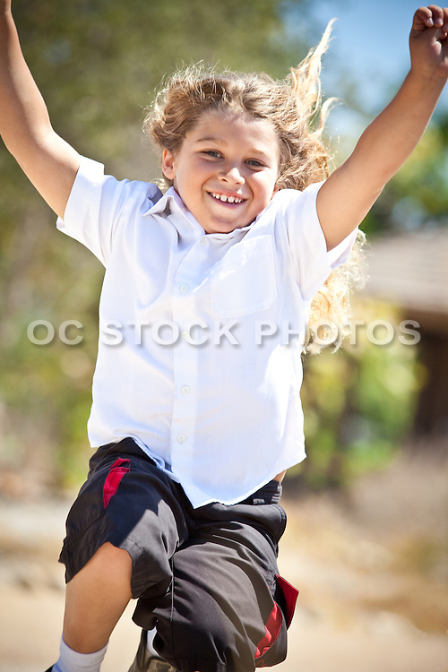 Young Boy Running And Jumping At The Park