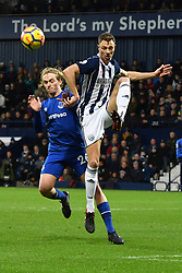 Everton's Tom Davies (left) and West Bromwich Albion's Jonny Evans in action