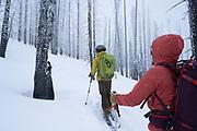 Diamond Peaks Ski Patrol members Mac Fuller and Teal Wyckoff climb through the Cameron Peak Fire burn scar near Montgomery Pass, Feb. 6, 2021.