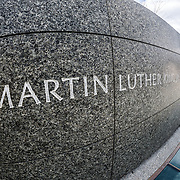 Martin Luther King Jr.'s name inscribed into the marble wall of the MLK Memorial next to the Tidal Basin in Washington DC. Distorted perspective from fisheye lens.