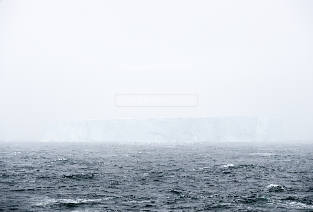 An iceberg appears through the mist in en route to Antarctica on Tuesday 13 February 2018.