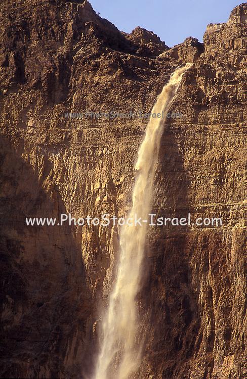 Israel, Judean Desert, a flash flood in Wadi Kedem causes a spectacular muddy waterfall