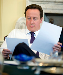 The Prime Minister David Cameron appointing new Ministers on the phone in his office inside Number 10 Downing street, May 13, 2010.  Photo By Andrew Parsons / i-Images.