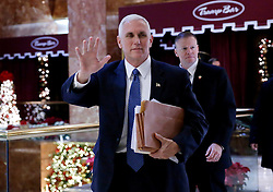 Vice President Elect Mike Pence walks through the lobby of Trump Tower on November 29, 2016 in New York City. Photo by John Angelillo/UPI