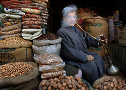 A Kashmiri store owner smokes a pipe in central Srinigar, February 12, 2002 in the Indian held state of Kashmir. India and Pakistan have already fought three wars over Kashmir and are the brink again as they amass their troops along the Line of Control.  (Ami Vitale)