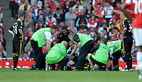 Jamie Carragher is stretchered Off after head injury with his team John Flanagan (Left)<br />Liverpool 2010/11<br />Arsenal V Liverpool (1-1) 17/04/11<br />The Premier League<br />Photo: Robin Parker Fotosports International