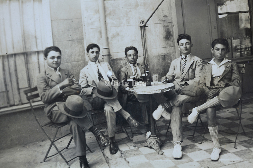 group of friends sitting and drinking together Spain