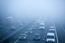 © Licensed to London News Pictures. 14/03/2014. Solihull, West Midlands, UK. Dense fog covered the Midlands earlier today. Pictured, the M42 motorway near Solihull, shrouded in fog. Photo credit : Dave Warren/LNP
