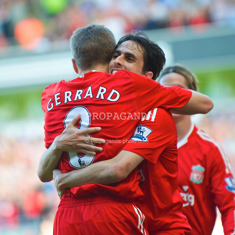 LIVERPOOL, ENGLAND - Saturday, September 12, 2009: Liverpool's Yossi Benayoun celebrates scoring the third goal against Burnley, with captain Steven Gerrard MBE during the Premiership match at Anfield. (Photo by David Rawcliffe/Propaganda)