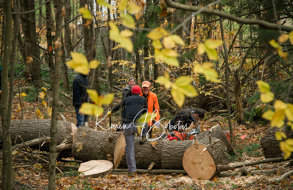 Mike Ware shares a light moment with Myles Chase as they work to clear the trails at Ramblin' Vewe Farm on Sunday morning.  (Karen Bobotas/for the Laconia Daily Sun)