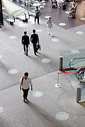 public space in large office building with business people walking