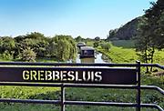 Nederland, the Netherlands, Wageningen, 14-5-2018De Grebbedijk tussen Wageningen en Rhenen ter hoogte van de Blauwe Kamer . . Deze loopt bij de Grebbesluis over in de natuurlijke waterkering van de Grebbeberg . In natuurgebied de Blauwe Kamer heeft het water van de Nederrijn vrij spel. Hierdoor is de natuur er voortdurend in beweging. De Grebbesluis fungeerde als waterinlaat voor defensie, hollandse waterlinie, bij een vijandelijke inval .Foto: Flip Franssen