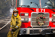 David Valadez, Los Angeles Fire Department, Class 1, Station 71 lean against their fire trucks. Firefighters arrived there at 4am, and they fights for straight over 10 hours. On Wednesday, December 6th, 2017. (Photo by Yuki Iwamura)