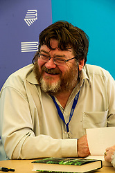 Pictured: John Burnside is a Scottish writer, born in Dunfermline. He is one of only two poets to have won both the T. S. Eliot Prize and the Forward Poetry Prize for the same book.<br /> <br /> Book fanatics headed to Charlotte Square in Edinburgh which is the hub of the international Book Festival to meet the authors and also to meet up with fellow fans of the printed word.<br /> <br /> <br /> Ger Harley | EEm 17 August 2017