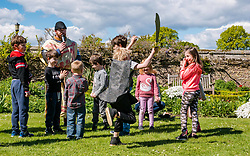 Medieval Day. Dirleton Castle, East Lothian, Scotland, United Kingdom, 11 May 2019. Pictured:  Historic Environment Scotland family fun day at the Living Medieval Village in the castle gardens.  Children learn to march in an army. Finn, aged 6 years, gets into the fighting spirit. <br /> <br /> Sally Anderson   EdinburghElitemedia.co.uk