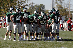 07 October 2006: Titan Offensive huddle.&#xD;The Titans of Illinois Wesleyan University started off strong with a touchdown on the 2nd play from scrimmage in the game.  The Titans led most of the way, but failed to maintain the lead in the 4th quarter giving up the decision of this CCIW conference game to the Red Men of Carthage by a score of 31 - 28. Action was at Wilder Field on the campus of Illinois Wesleyan University in Bloomington Illinois.<br />