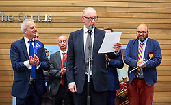 © Licensed to London News Pictures. 09/06/2017. Aylesbury, UK.  Announcement of the results for the Aylesbury constituency in the 2017 general election. In this picture: Andrew Grant (returning officer), David Lidington (Conservative) (far left), Mark Bateman (Labour) (2nd left) and Vijay Singh Srao (UKIP) (fr right).  Photo credit: Cliff Hide/LNP