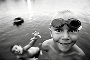 Two brothers play together at a lake while on summer vacation