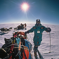 Keizo Funatsu, Will Steger and Qin Dahe guide their dogsleds across the vast polar plateau near the South Pole, about halfway through the 1989-1990 Trans-Antarctica Expedition.
