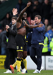 Burton Albion's Hope Akpan, (left) shows his appreciation to the fans alongside manager Nigel Clough, (right) after the match