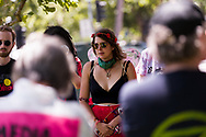 Protest leader, Violet CoCo is seen speaking to a group of protesters during an Extinction Rebellion protest in Melbourne.  A small group of climate protesters marched from Flagstaff Gardens to The Queen Victoria Market and ending with two individuals gluing themselves together, and then glued themselves to Victoria Avenue outside of the Market. This comes as 5 new COVID-19 cases were uncovered in Melbourne's revamped Hotel Quarantine, breaking almost 40 days of virus free days. (Photo by Dave Hewison/Speed Media)