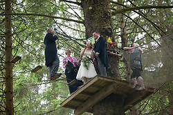 Martin Milner and Colette Gregory tying the knot in the trees at Go Ape Aberfoyle.