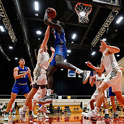 Chaminade forward Bill Awet (12) grabs a rebound over Point Loma forward Noah Stapes (23) during the PacWest basketball championships semifinals in the Felix Event Center at Azusa Pacific University Friday, Mar. 6, 202, in Azusa. (Mandatory Credit: Christina Leung-Sports Shooter Academy)