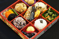 """Bento Box Lunch - The origin of bento can be traced back to the Kamakura Period when cooked and dried rice called hoshi-ii literally """"dried meal"""" was developed. In the Edo Period bento culture spread and became more refined. Bento became even more popular in the 80s with the help of the microwave and the proliferation of convenience stores. The expensive wood and metal boxes have been replaced at most bento shops with inexpensive, disposable plastic ones Even handmade bento have made a comeback, and they are once again a common sight at picnics."""