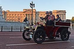 Participants drive along The Mall in the Bonhams London to Brighton Veteran Car Run in central London.