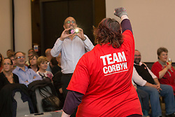 © Licensed to London News Pictures. 25/08/2015. Southampton, UK.  One of Jeremy Corbyn's support team members shows her enthusiasm ahead of a rally held in the Hilton at the Ageas Bowl in Southampton after rumours for a Labour split.
