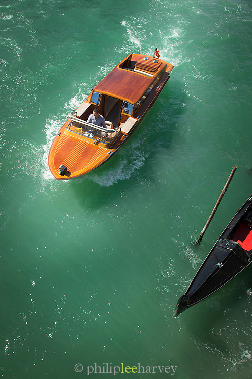 A Water Taxi and gondola on the Grand Canal. Venice, Italy, Europe