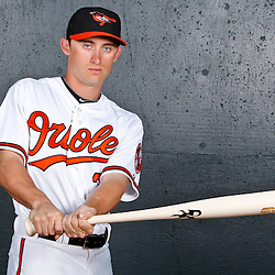 February 26, 2011; Sarasota, FL, USA; Baltimore Orioles left fielder Matt Angle (38) poses during photo day at Ed Smith Stadium.  Mandatory Credit: Derick E. Hingle