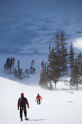 Grace Marx and Obadiah Reid descend towards Black Lake in Rocky Mountain National Park, Colorado.