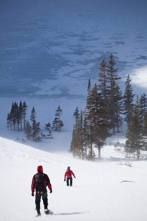 Grace Marx and Obadiah Reid descend towards Black Lake in Rocky Mountain National Park, Colorado.