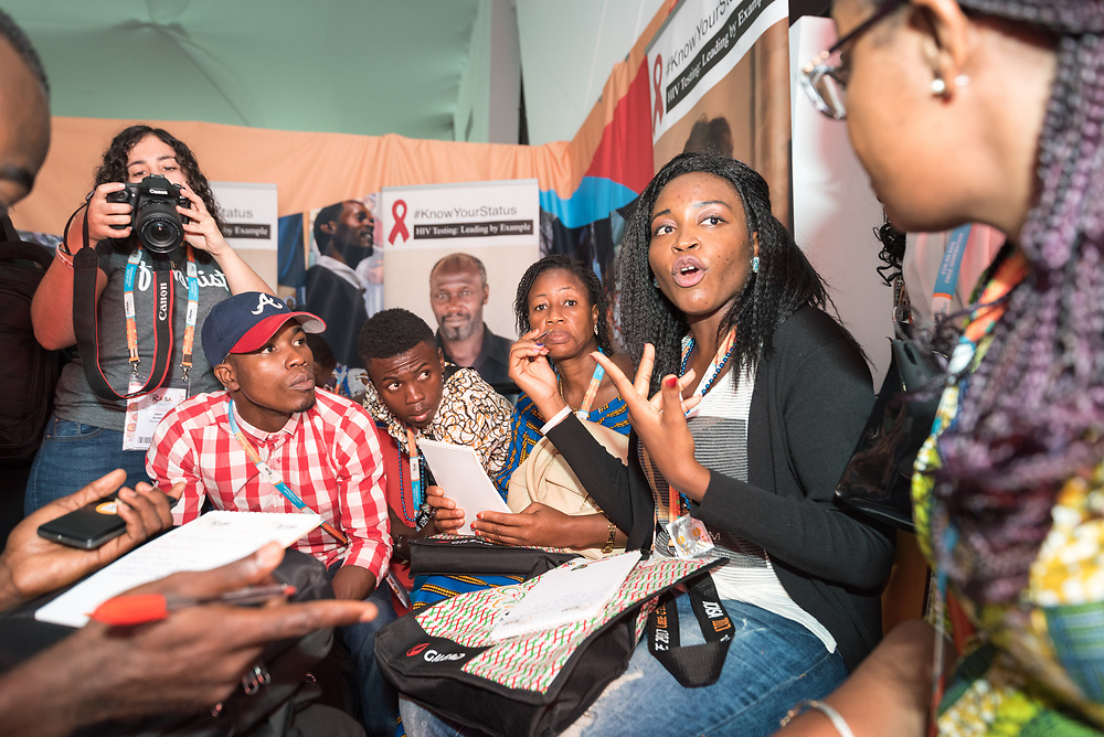 5 December 2017, Abidjan, Côte d'Ivoire: Young Women's Christian Association (YWCA) leads a workshop in the Faith Networking Zone in the Global Village area of ICASA 2017. The 19th International Conference on AIDS and STIs in Africa (ICASA) 2017 gathers thousands of researchers, medical professionals, academics, activists and faith-based organizations from all over the world, all looking to overcome the HIV epidemic and eliminate AIDS as a public health threat. Through a Faith Networking Zone, the World Council of Churches offers a space highlighting the role of faith-based organizations in the global response to HIV. Throughout ICASA, the Faith Networking Zone hosts a range of activities, including prayers, debriefing sessions, and workshops.